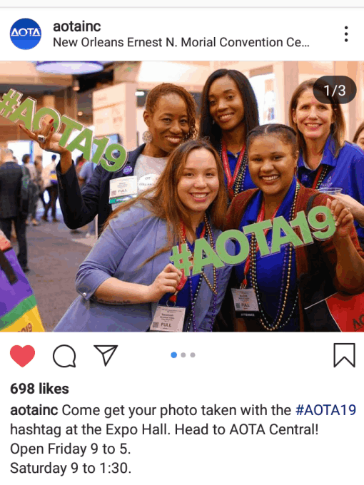 AOTA members hold up the hashtag sign at Conference